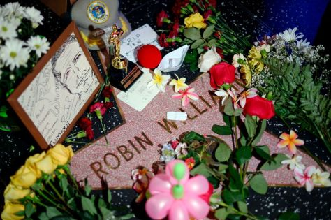 Robin Williams  On his star in Los Angeles.